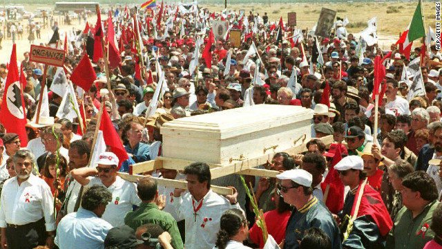 An estimated 25,000 mourners accompany Chavez's pine casket through farmlands to his funeral Mass in Delano, California, on April 29, 1993.