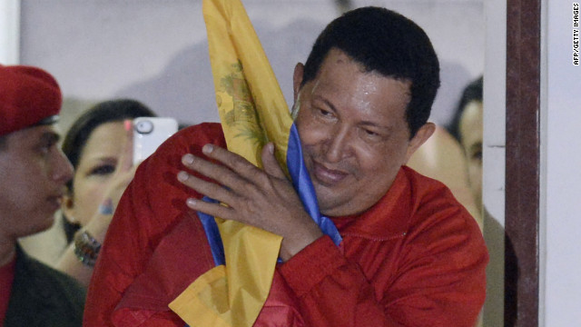 Hugo Chavez embraces a Venezuelan flag after winning re-election Sunday, October 7. Chavez, who has been Venezuela's president since 1999, defeated Henrique Capriles Radonski. &lt;a href='http://www.cnn.com/SPECIALS/world/photography/index.html' target='_blank'&gt;See more of CNN's best photography&lt;/a&gt;.