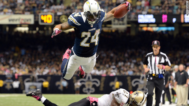 Ryan Mathews of the San Diego Chargers dives over Malcolm Jenkins of the New Orleans Saints to score a touchdown and take a 24-14 lead during the third quarter on Sunday, October 7, at the Mercedes-Benz Superdome in New Orleans.