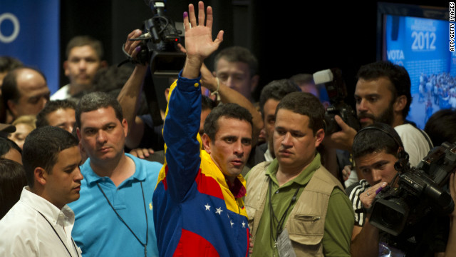 Opposition candidate Henrique Capriles Radonski waves to supporters Sunday night in Caracas after learning of his defeat. During the campaign, he criticized the Chavez administration for inefficiencies, infrastructure shortcomings and corruption.