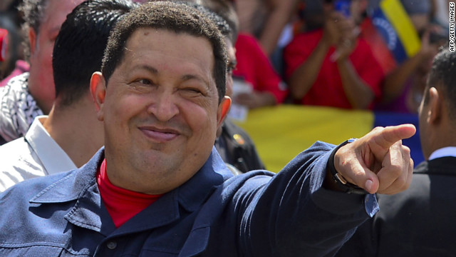Chavez greets a crowd before voting Sunday. The 58-year-old leader has been weakened by two surgeries for cancer, keeping secret the type of cancer and his prognosis. <a href='http://www.cnn.com/2012/10/03/americas/gallery/venezuela-election/index.html' target='_blank'>Photos: Venezuela's presidential vote</a>