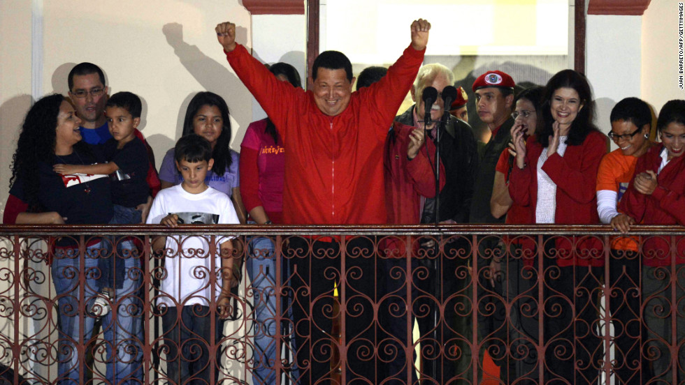 Venezuelan President Hugo Chavez greets supporters after receiving news of his re-election in Caracas on Sunday, October 7. With 90% of the ballots counted, Chavez, who has been president since 1999, defeated Henrique Capriles Radonski with 54.42% of the votes, according to an National Electoral Council official.<a href='http://www.cnn.com/2012/10/03/americas/gallery/venezuela-election/index.html' target='_blank'> Photos: Venezuela's presidential vote</a>