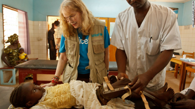 UNICEF Goodwill Ambassador Mia Farrow chats with seven-year-old Massi Hassan, whose leg brace is being adjusted by a health worker, at the Notre-Dame de Paix rehabilitation centre in the town of Moundou in southwestern Chad.