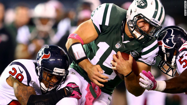 Backup quarterback Tim Tebow of the Jets is tackled after running the ball against the Texans on Monday.