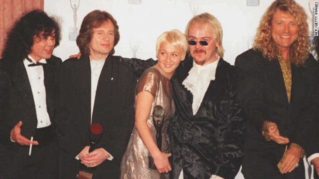 Page, Jones and Plant are joined by the late Bonham's children, Zoe and Jason, after the group's induction into the Rock and Roll Hall of Fame in 1995.