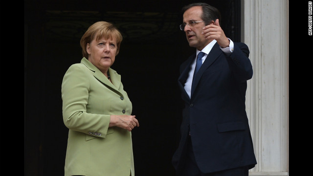 Greek Prime Minister Antonis Samaras welcomes German Chancellor Angela Merkel before their meeting in Athens.
