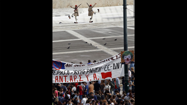 Protesters gather in front of the Greek Parliament in Syntagma Square.