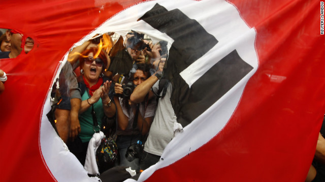 Photos: Greeks protest German chancellor\'s visit