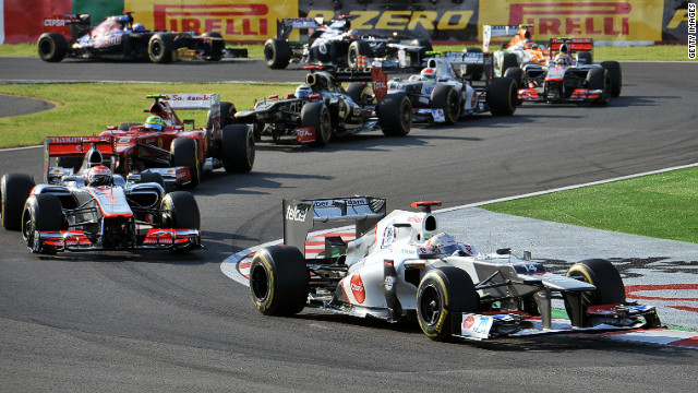 Kobayashi leads a group during Sunday's Grand Prix at the famous Suzuka circuit. 