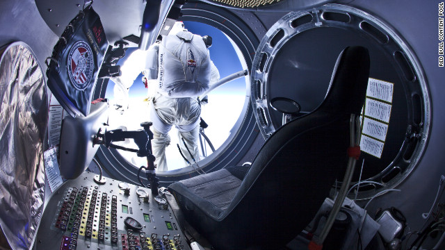 Baumgartner steps out from the capsule during the second manned test flight on July 25.