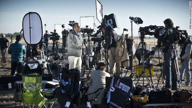 TV crews report from the launch site.