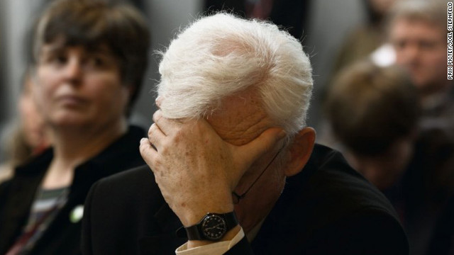 A priest holds his head at the Commission on Ecology and Religion in Japan as part of Joel Sternfeld's series &quot;When it Changed.&quot; On Prix Pictet's website, Sternfeld says he tried to capture &quot;the sense of anxiety and urgency&quot; as the danger of climate change became more apparent. He says the title of his series also reflects the hope that global warming can be curtailed.