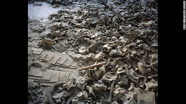 "Gas masks cover the floor of a school lobby in the abandoned city of Prypiat, Ukraine, in an image from Rena Effendi's series ""Still Life in the Zone."" Residents had to leave Prypiat following the 1986 Chernobyl nuclear disaster and could not return to live."