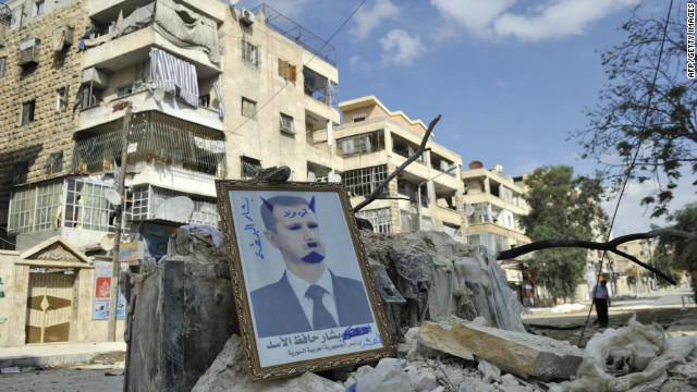 A portrait of Syrian President Bashar al-Assad sits on rubble along a street in the Saif al-Dawla district of Aleppo on Tuesday.