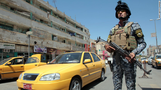 An Iraqi policeman stands guard at a checkpoint in central Baghdad. It has been 10 months since U.S. combat troops left, but it is far from peace time in Iraq.