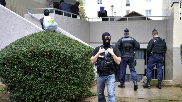 Police investigate outside lock-up garages possibly used by terror suspects in Torcy, east of Paris on October 10, 2012.