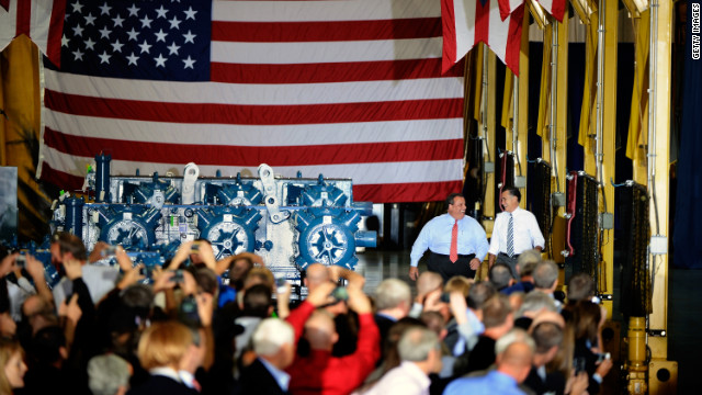Christie, left, and Romney walk up to the stage at Ariel Corporation in Mount Vernon, Ohio, on Wednesday.
