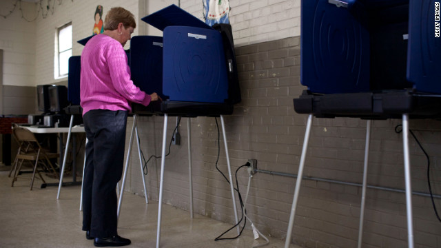 South Carolina's voter photo ID law will not go into effect until next year, a federal court panel in Washington ruled Wednesday .