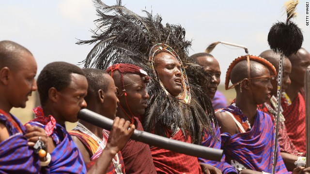 Masai men giving a traditional greeting at Majengo Maasai Boma in Arusha, Tanzania.