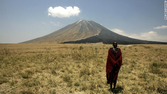 A Masai tribesman stands on the slopes leading up to the Ol Doinyo Lengai volcano in the Ngorongoro Conservation Area, one of seven UNESCO World Heritage Sites in Tanzania.