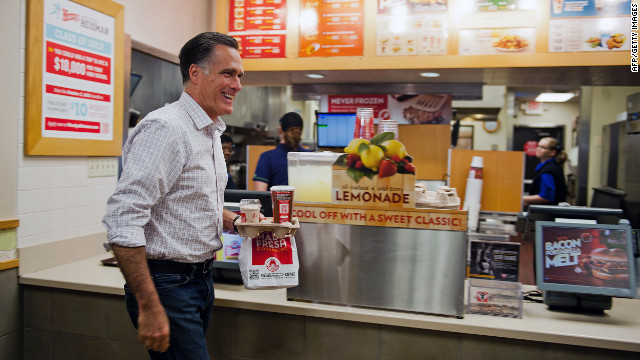 Republican presidential candidate Mitt Romney departs a Wendy's restaurant with his dinner order in Cuyahoga Falls, Ohio, on Tuesday.
