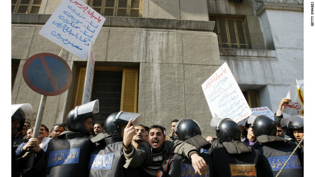 Egyptian riot policemen stop protesters from approaching the parliament building in downtown Cairo during a demonstration in 2011 by people calling for an end to poverty and unemployment.
