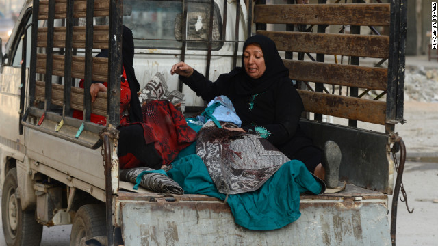 An injured Syrian woman rides to a hospital after an airstrike by regime forces in Aleppo on Tuesday.