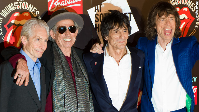 Charlie Watts, Keith Richards, Ronnie Wood and Mick Jagger celebrate the launch of