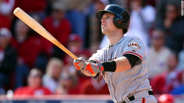 San Francisco Giants catcher Buster Posey hits a grand slam home run in the fifth inning Thursday against the Cincinnati Reds. The Giants scored all six of their runs in that inning and won the game 6-4.