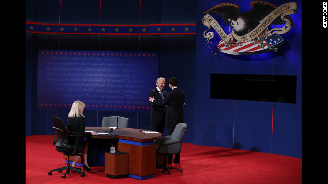 Vice President Biden greets Republican vice presidential candidate Paul Ryan as they take the stage.