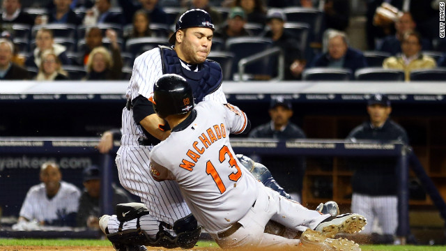 Yankees catcher Russell Martin tags Baltimore's Manny Machado out at the plate on a fielder's choice in the third inning Thursday.