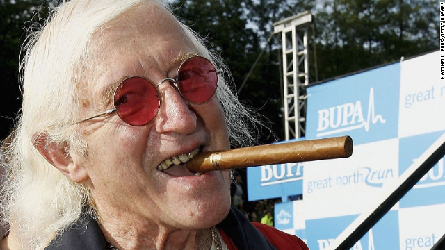 Days before his 80th birthday in 2006, Savile prepares for the Great North Run in Newcastle, northern England.