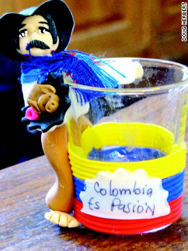 "Nothing says ""Colombian passion"" like a local holding a pig in a blanket while humping a life-size shot glass."