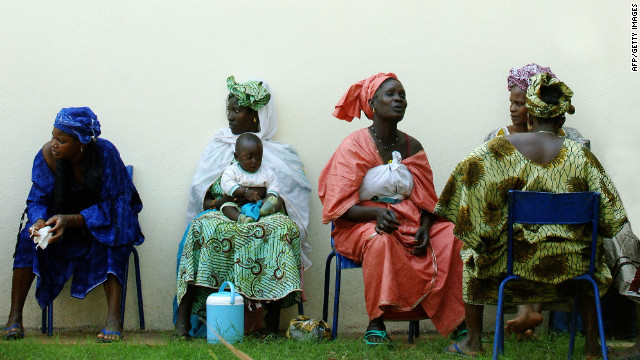 Women wait for the start of a gathering on women's rights in Bamako, Mali. The U.N. voiced fears over women's rights.