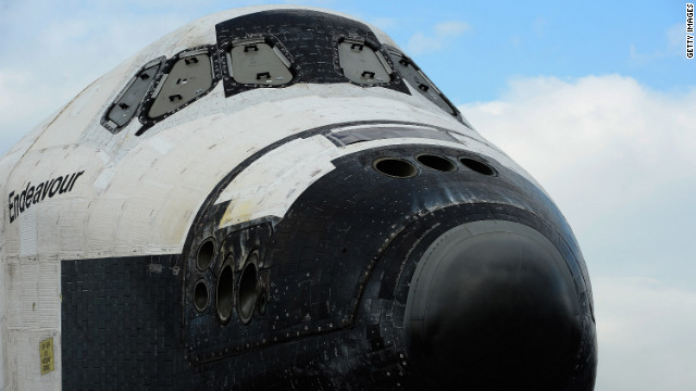The space shuttle Endeavour is parked in a mall parking lot on its way to the California Science Center.