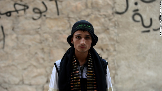 A Syrian opposition fighter stands near a post in Aleppo on October 11.
