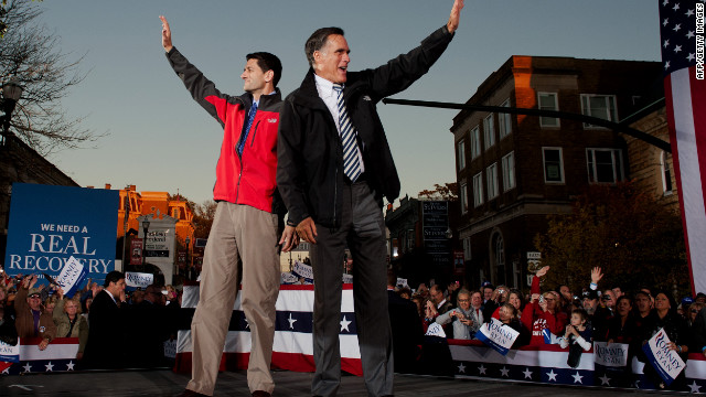 Romney, right, and GOP vice-presidential candidate Paul Ryan greet supporters as they arrive at a rally in Lancaster, Ohio, on Friday.