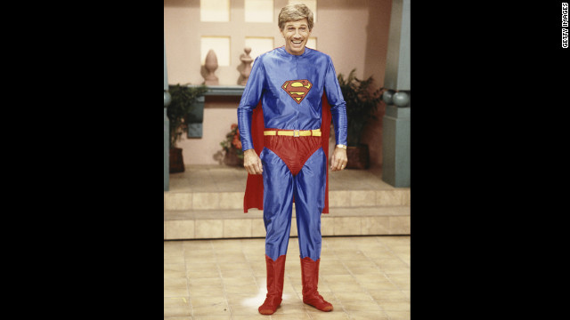 Collins poses in a Superman costume during the taping of &quot;Hour Magazine&quot; in 1987 in West Hollywood, California.