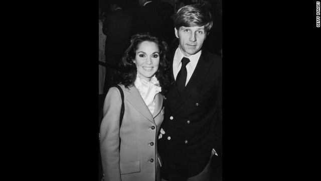 Collins and his wife, Mary Ann Mobley, appear together at an unidentified event.