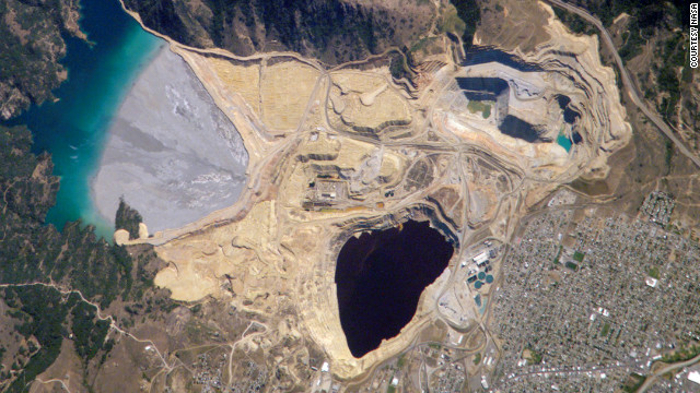 With its water dyed ruby-red from wickedly toxic chemicals left over from aggressive strip mining, the Berkeley Pit is the crowning jewel in the nation's largest contiguous Superfund site. Not so gross to look at, right? Brace yourself for the next photo.