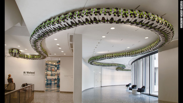 """Snake Ceiling"" (2009) uses hundreds of backpacks to represent children's backpacks left behind after the 2008 Sichuan earthquake."