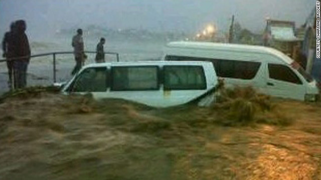 On Bay Road in Basseterre, St. Kitts, two taxis were washed down to the shoreline when they tried to cross the flooded road.