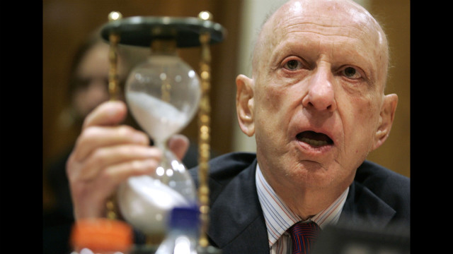 Specter, then chairman of a subcommittee of the Senate Appropriations Committee, holds up an hourglass during his opening statements at a hearing on stem cell research in July 2005.
