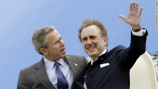 President George W. Bush, left, and Specter arrive at Harrisburg International Airport in Harrisburg, Pennsylvania, in April 2004.