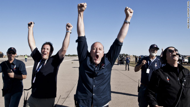 Crew members celebrate Sunday's successful launch. Baumgartner hoped to be the first person to break the sound barrier without the protection of a vehicle.