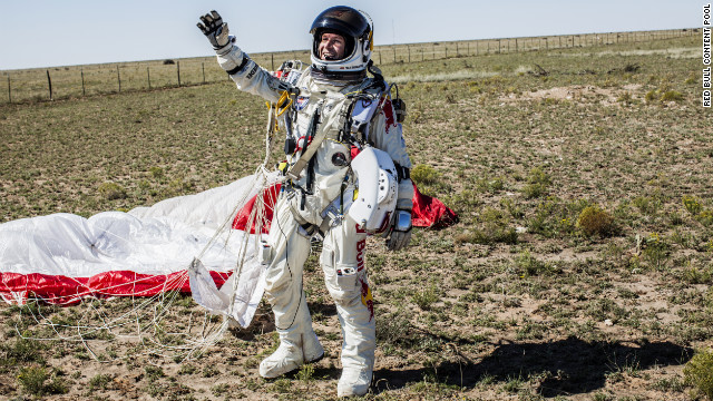 Baumgartner celebrates after successfully completing the final manned flight for Red Bull Stratos mission.