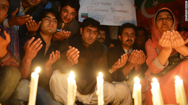 Supporters place candles to pay tribute to Malala in Islamabad on Wednesday.