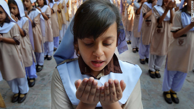 Pakistani school girls pray for the recovery of teen activist Malala Yousufzai at their school in Peshawar on Friday.
