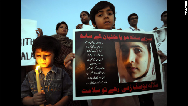 Children of Pakistani journalists and civil society activists light candles in Islamabad on Wednesday.