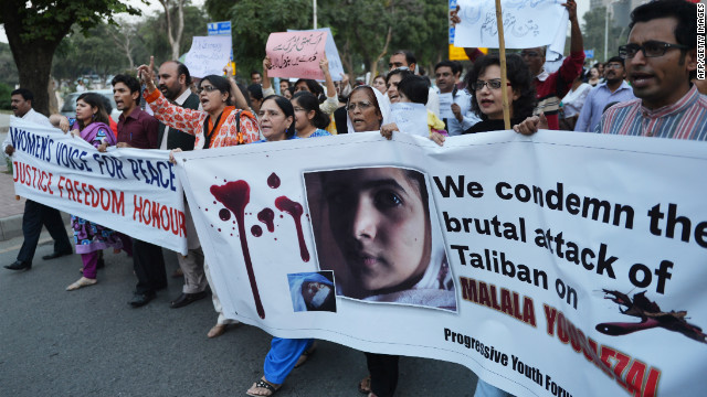 Pakistani civil society activists carry banners in Islamabad on Wednesday as they shout ant-Taliban slogans during a protest against the assassination attempt.